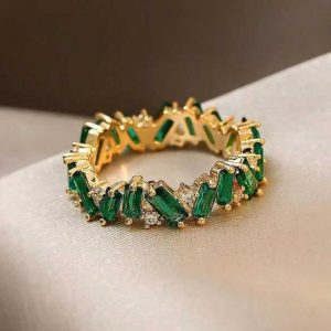 Detailed Green and Gold Ring